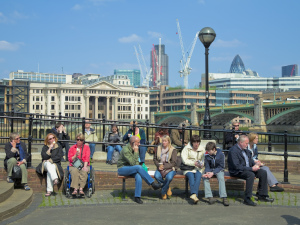 A lady in a wheelchair on the South Bank; Copyright: Visit London Images