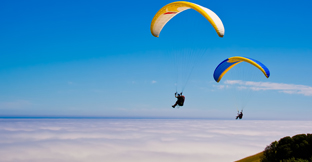 Two paragliders above the East Sussex coast