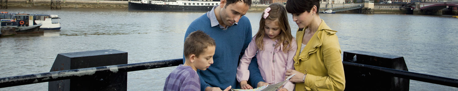 A family on a boat looking at a map