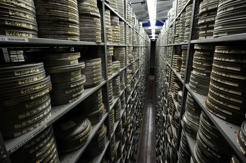 Film reels piled up high at BFI National Archive