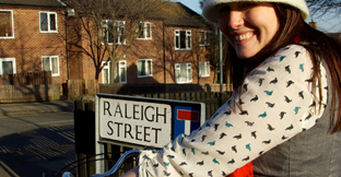 A cyclist stood next to Rayleigh Street sign