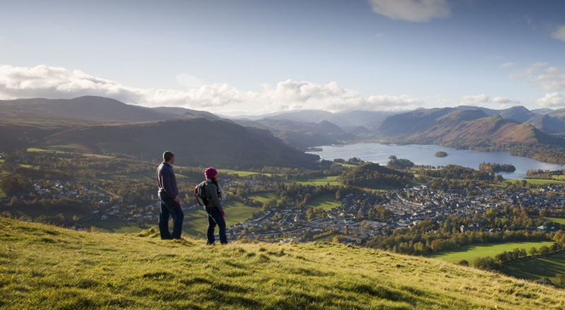 A couple look over Derwent Water in Keswick