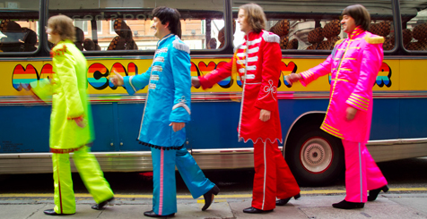 Four men dressed as The Beatles