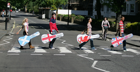 Four people recreating the Abbey Road pose