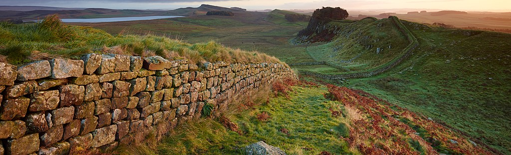Hadrian's Wall near Housesteads. A section of the historic Roman stone wall fortification in Northern England started in AD 122. A UNESCO world heritage site.