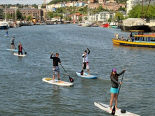 Paddle boarders exploring Bristol Harbour