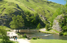 Hop over stepping stones across the River Dore at Dovedale