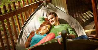 A couple in a hammock in the forest