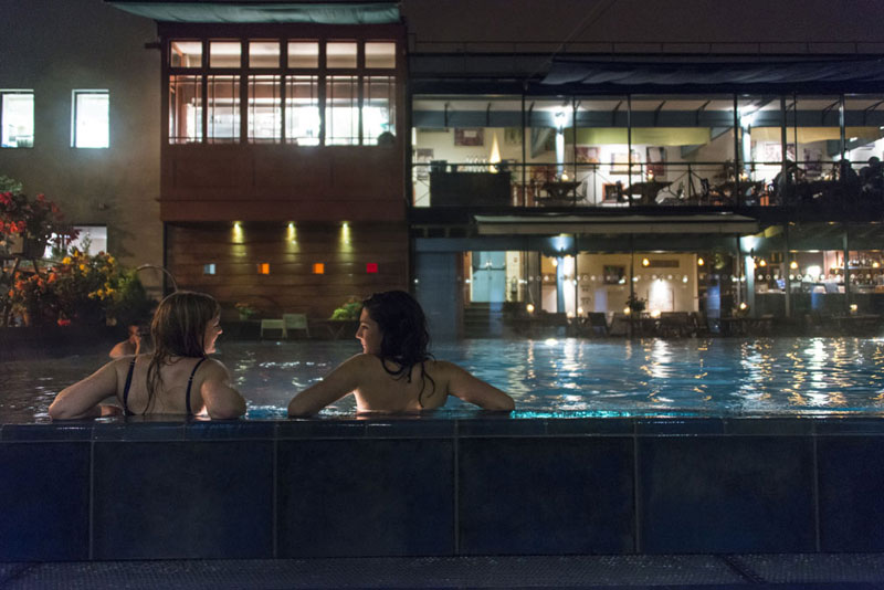 Two women relaxing in the pool at Lido in Bristol
