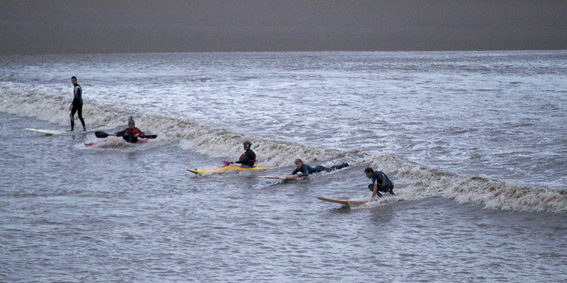 Surfers on the Severn Bore © VisitEngland