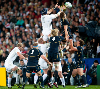 Rugby players leaping to catch a ball