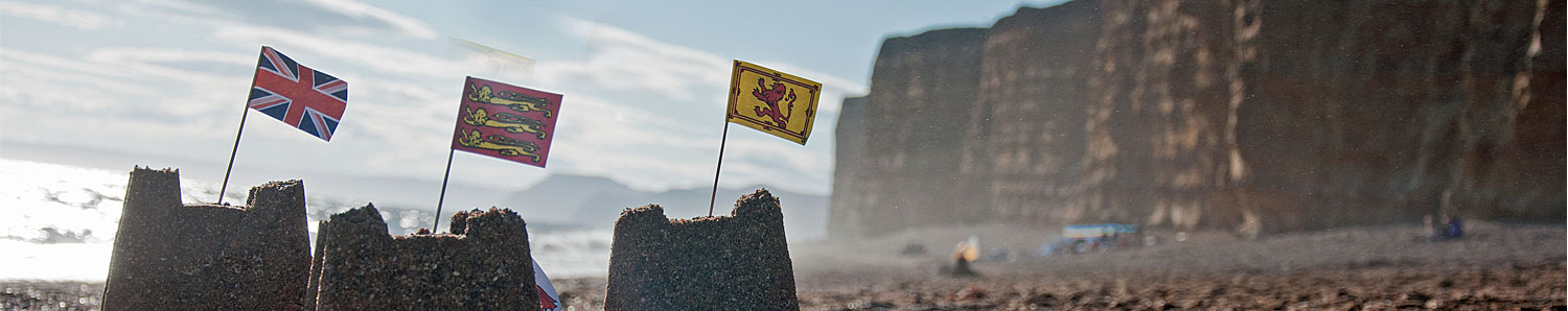 Image of sandcastles with English flags, Dorset