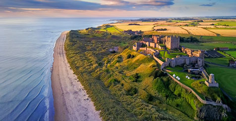 Aerial view of Bamburgh Castle on the coast of Northumberland, England.