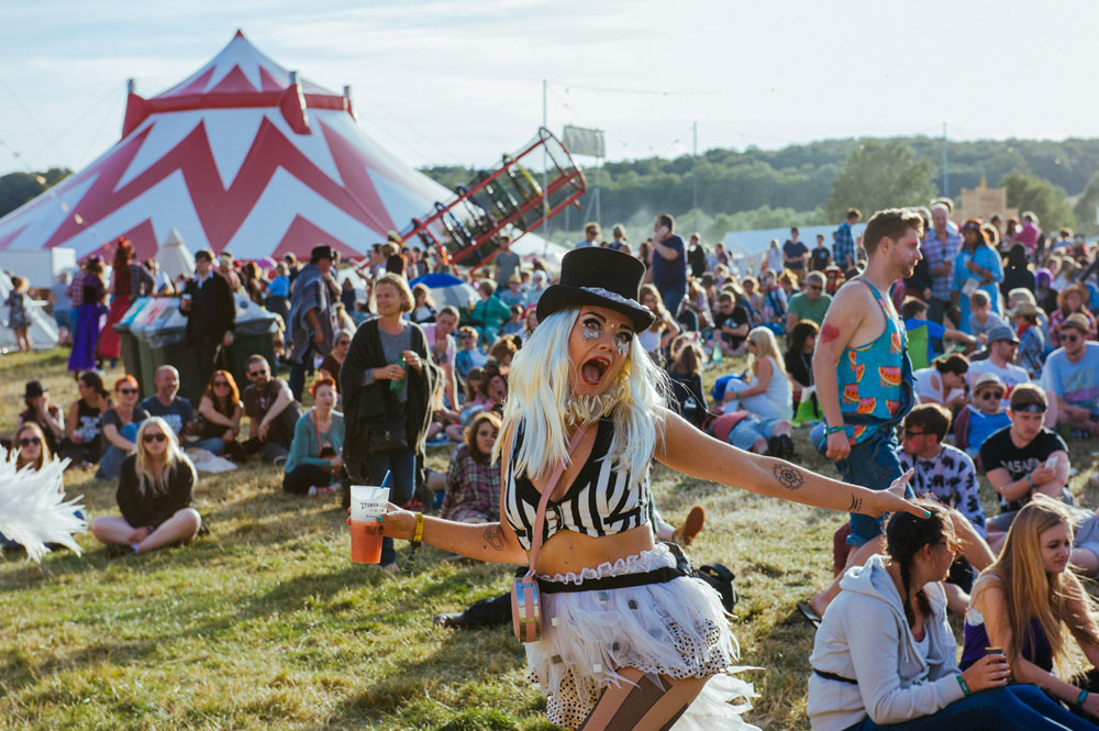 A festival reveller in fancy dress