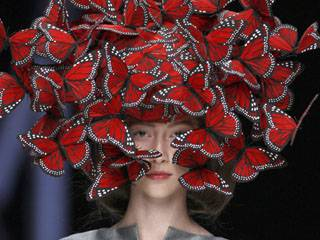 Hand-painted butterfly headdress by Philip Treacy for Alexander McQueen