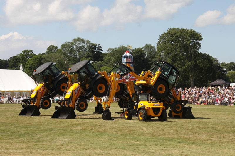 A trio of JCBs perform at the Holkham Country Fair