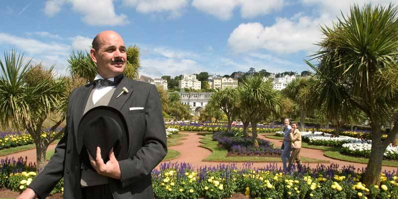 An actor posing as Poirot on the English Riviera