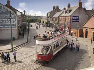 A Victorian tram makes it way through Beamish - The Living Museum of the North,
