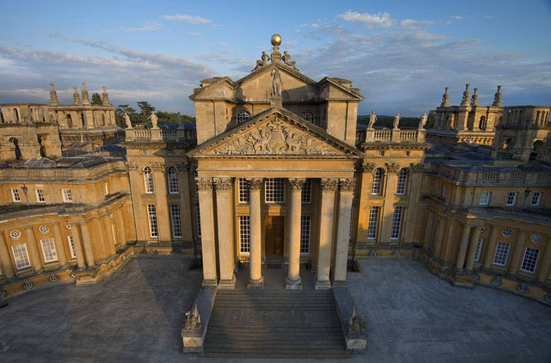 The grand, honey-coloured columned entrance of Blenheim Palace
