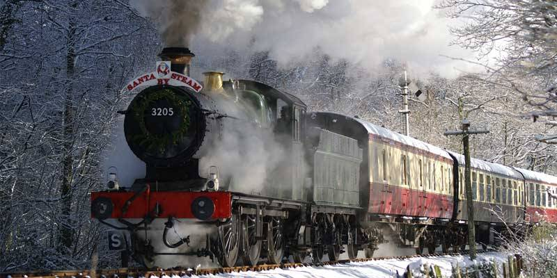 A steam train arriving at Staverton Statioon