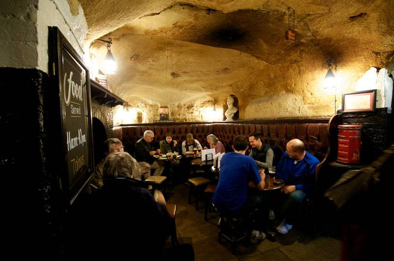 People sitting in a cosy snug at England's oldest pub