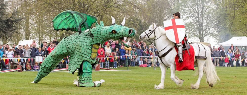 A battle between a St George and the dragon is played in the grounds of Beeston Castle