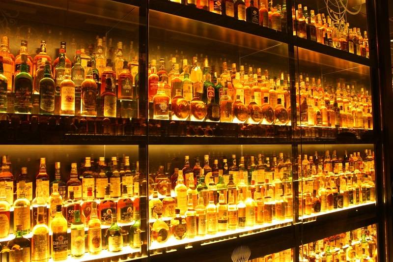Cases of whiskey on a shelf