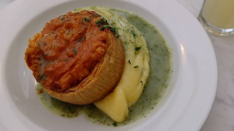 A plate of pie and mash