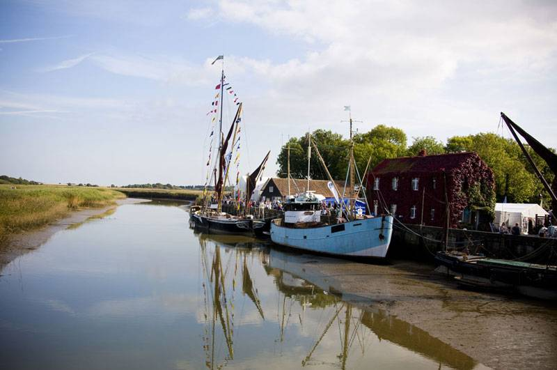 Boats moored on River Alde in Snape Maltings