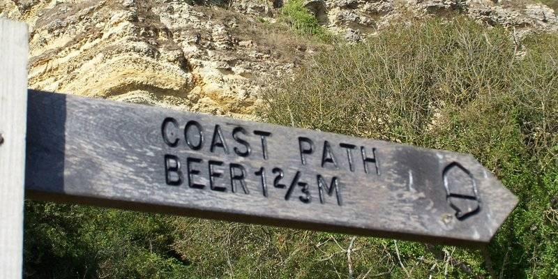 Signpost to Beer on the South West Coast Path
