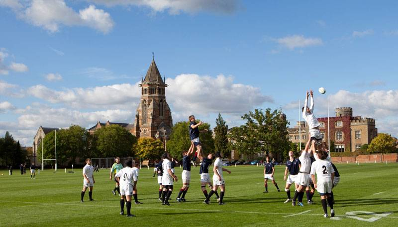 Rugby players battle it out on the pitch at the Rugby School