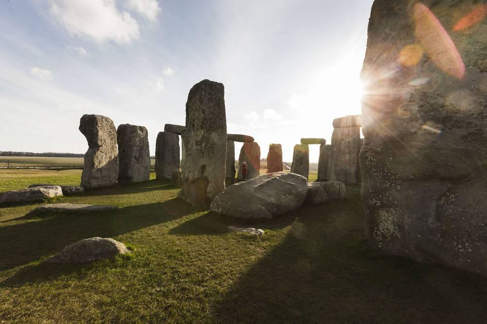 The sun breaks through a gap in Stonehenge