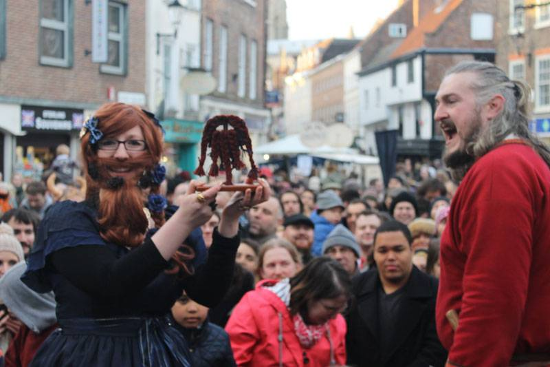 Contestants wearing fake beards compete for the Best Beard Contest