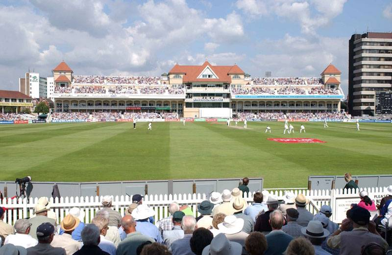 Spectators watch a game of cricket unfold at Trent Bridge in Nottingham