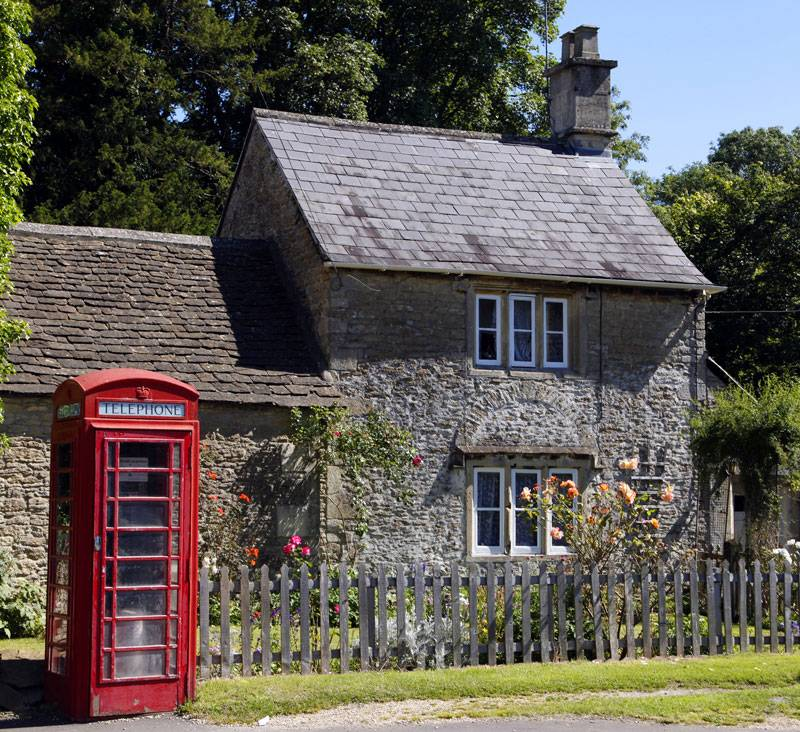 A postcard-perfect red telephone box and cottage combination in Corsham, Wiltshire.