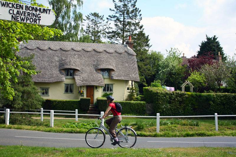 A ridiculously quaint snapshot of a thatched cottage and cyclist in Arkesden Village in Essex…