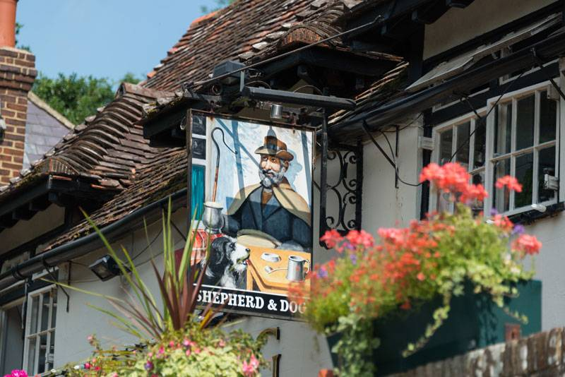 A cheery pub sign for The Shepherd and Dog in Fulking, West Sussex