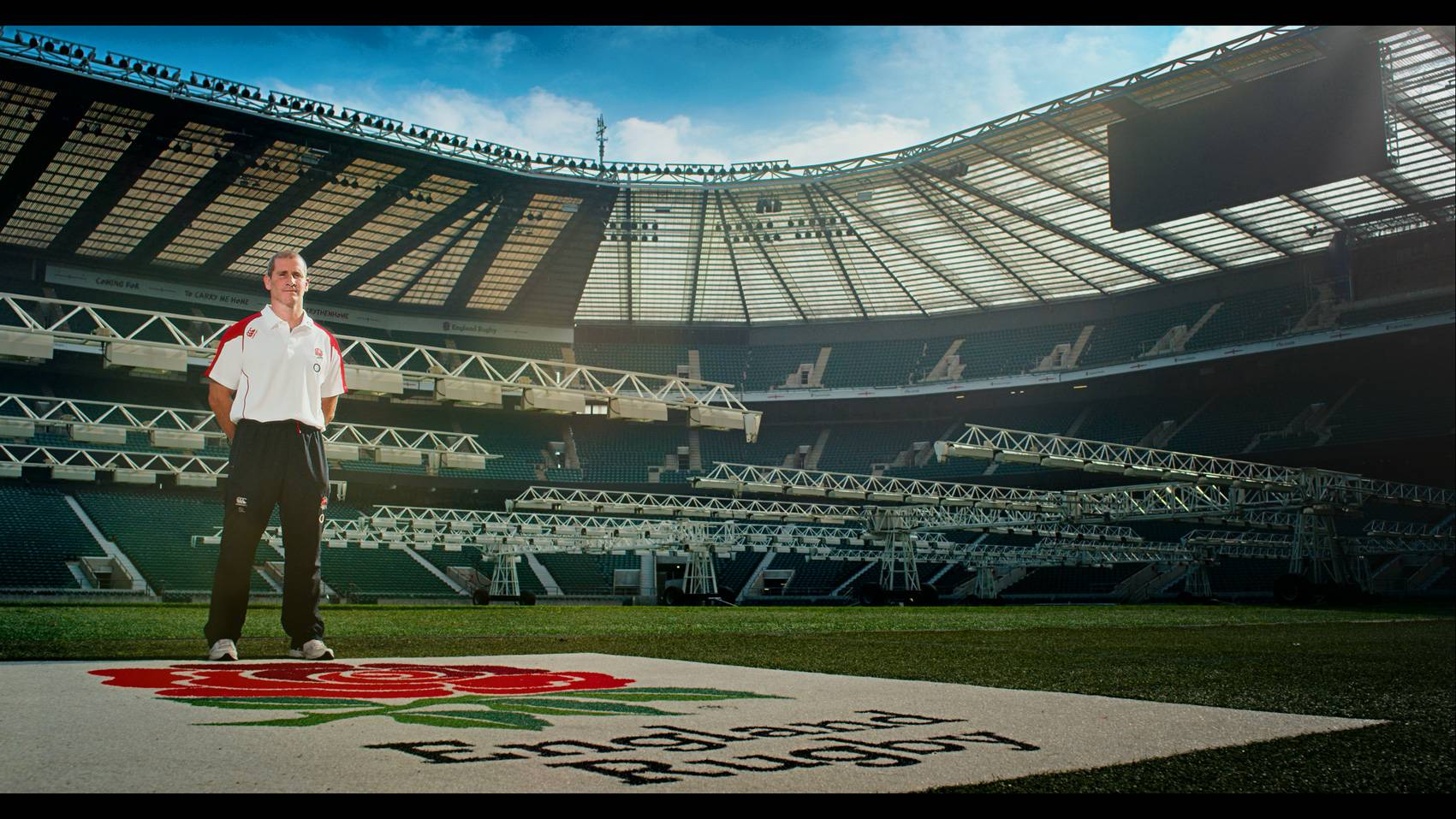 Rugby World Cup TV ad still of Stuart Lancaster on the pitch at Twickenham