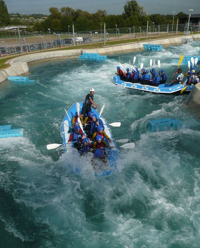 A group tackle the choppy waters of Lee Valley White Water Centre