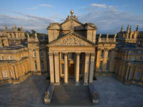 The grand honey-coloured columned entrance of Blenheim Palace