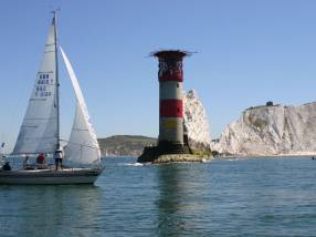 A waterborne sailing boat taking part in the Round the Island Race