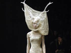 Tulle and lace dress with veil and antlers, Widows of Culloden, AW 2006-07. Model Raquel Zimmermann, Viva London. Image firstVIEW