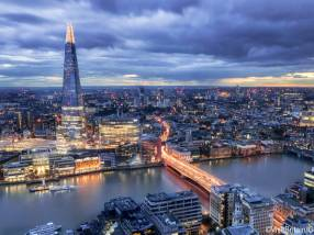 City skyline at night and the Thames, London, Greater London