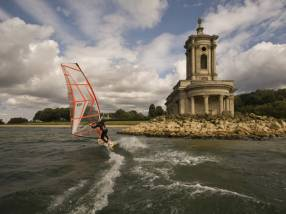 A wind surfer in front of Normanton Church at Rultand Water