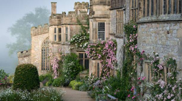 Haddon Hall, bedecked with pink flowers, in the spring