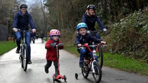 Two adults and two children riding on the Regency Cheltenham Cycle Trail.