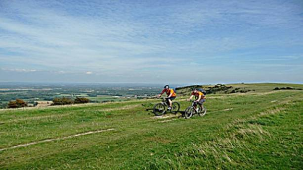 A photo of two cyclists on the South Downs.