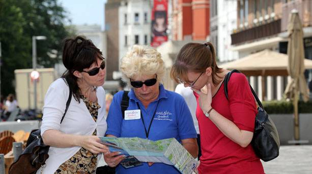 Three women looking at a map in Brighton