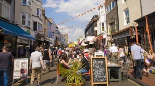 People shopping and eating out in the North Laine area of Brighton.