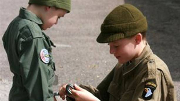 Two young boys kitted and ready to play at 1940s festival at East Lancashire Railway